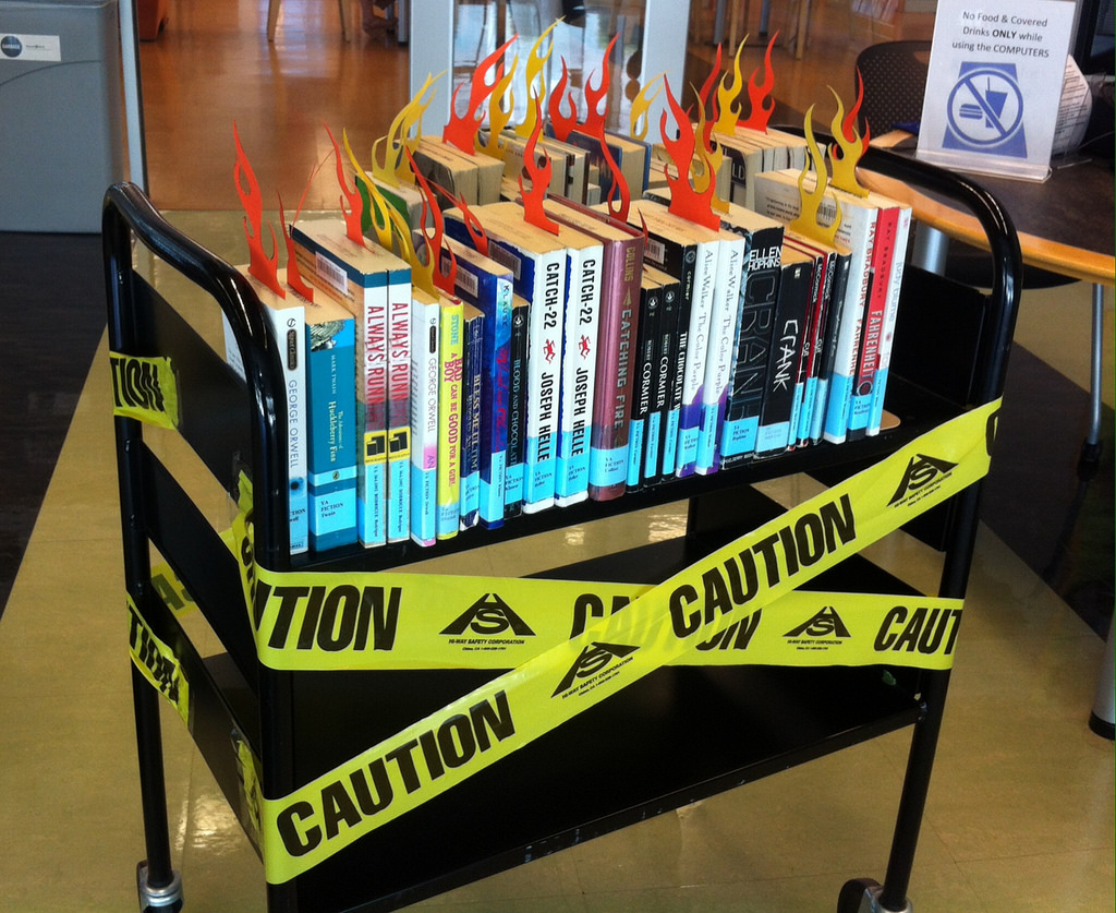 Many books have been banned from libraries both in schools and in our community. This picture represents burning books. Photo courtesy of flickr.com