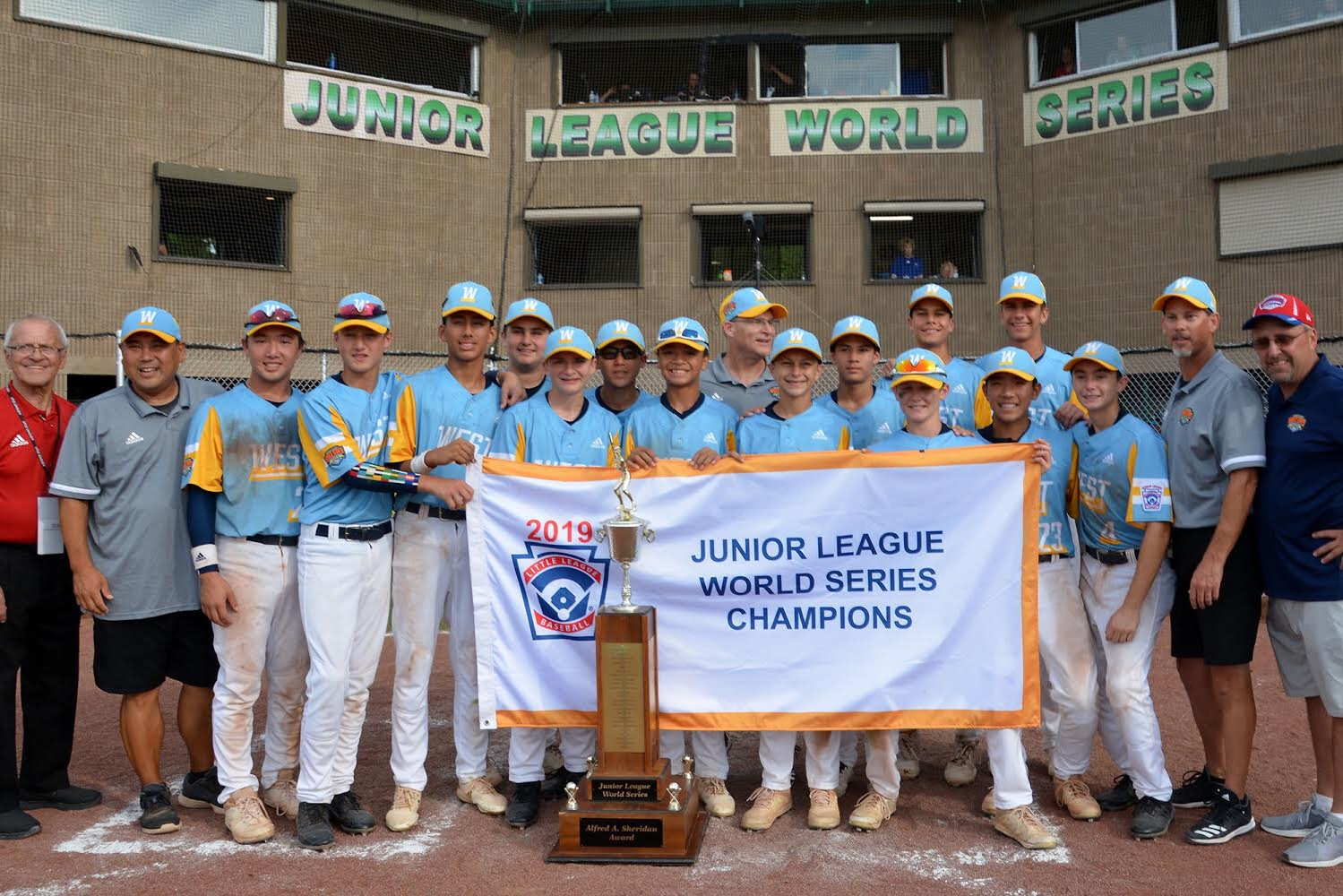 This is a photo of the Golden Hill Little League. Tyler Simkins is in the middle with blue sunglasses.
