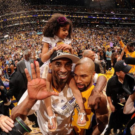 Kobe Bryant celebrating with daughter after 2010 Lakers NBA Championship win