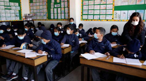 Creative Commons: Students wearing masks to school during a pandemic