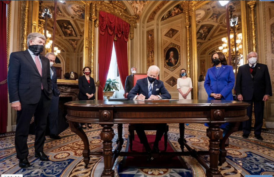 Biden signs flurry of executive orders, undoing Trump-era policies